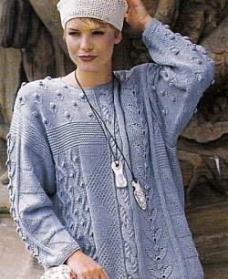 Женский пуловер с красивыми узорами